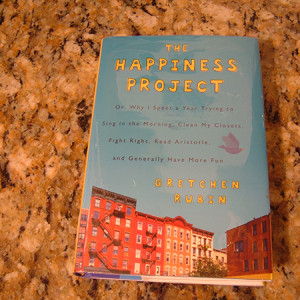 """The happiness project"" by Gretchen Rubin."